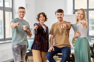 business team pointing fingers to camera at office