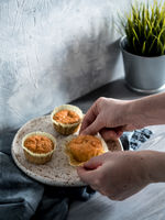 carrot muffins on gray wooden table