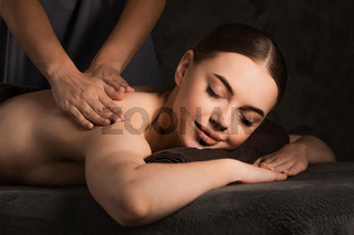 Woman at hand massage in beauty spa