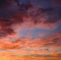 Beautiful multi colored sunset square view. Full frame cloudy sky background