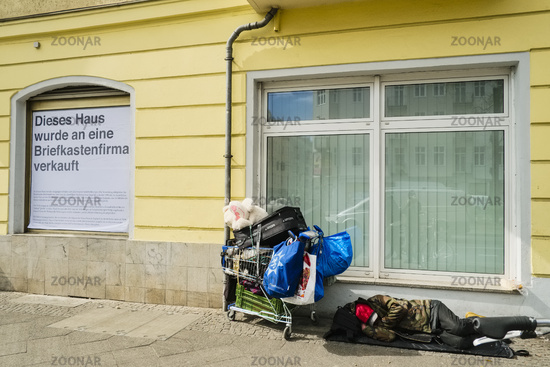 Rough sleeper with shopping cart, Berlin, Germany