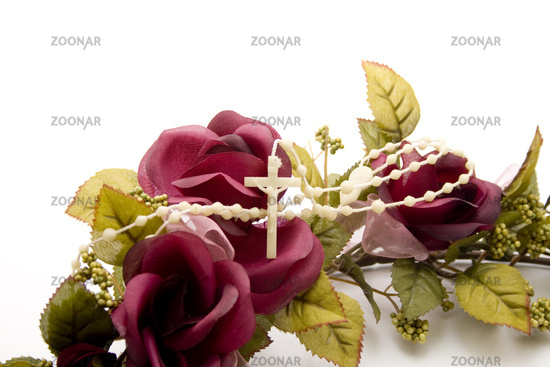 Plastic cross with rose branch
