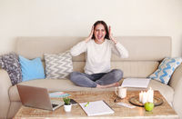 Stressed woman working remotely at home