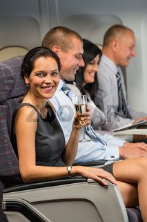 Young businesswoman enjoy flight glass champagne