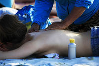 Indonesian women massage girls to tourists on the beach