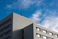 An antenna on a minimalist gray building