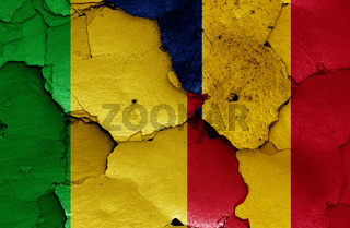 flags of Mali and Chad painted on cracked wall