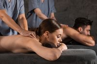 Couple relaxing together at spa centre