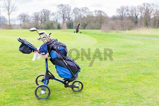 Golf trolley parked on dutch golf course