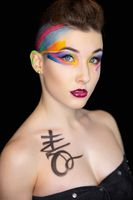 Young beautiful woman with creative make up