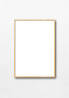 Wooden picture frame hanging on a white wall