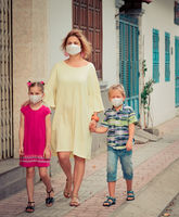 Family wearing facial disposable mask. Coronavirus protection