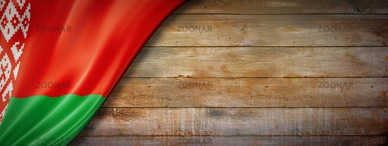 Belarus flag on vintage wood wall banner