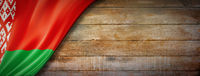 Belarus flag on vintage wood wall banner