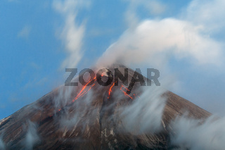 Volcanic eruption - lava flows from crater of volcano Kamchatka Peninsula
