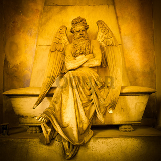 Angel statue on a 1820 tomb located in an old Italian cemetery