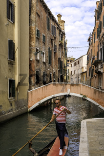 Gondolier and Tourists at Gondolas in Venice