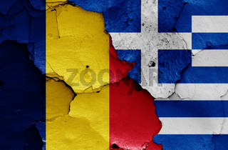 flags of Romania and Greece painted on cracked wall