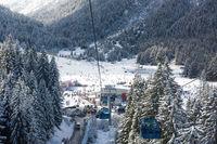 Snowy ski slopes and chair ski lifts station in  mountain ski resort.