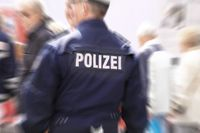 Backside of a german policeman with blurr effect