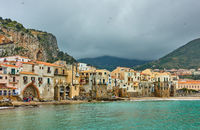 Old houses by the sea in Cefalu in Sicily