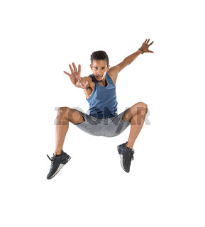 Young handsome man high jumping in studio isolated on white background