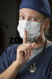 Secretive Female Doctor with Finger in Front of Mouth