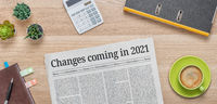 A newspaper on a desk with the headline Changes coming in 2021