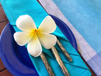 Food decoration with white plumeria rubra flower,  Sri Lanka.