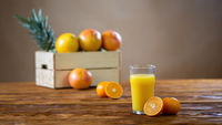 Refreshment from squeezed oranges in a tall glass.