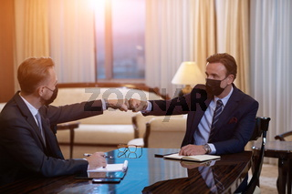 business people wearing face mask on meeting and handshake