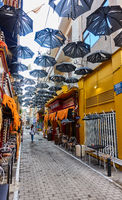 Street decorated with torn umbrellas in Athens