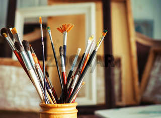 Close up of painting brushes in studio of artist