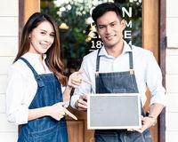 Cafe Owner holdind chalkboard