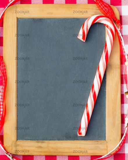 Christmas candy on vintage blackboard