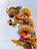 Golden Chinese Dragon sculpture on the Pole