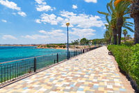 Picturesque seafront promenade of Punta Prima. Spain