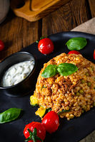 rustic bulgur fried with minced meat and vegetables