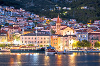 Town of Makarska waterfront and Biokovo mountain evening view