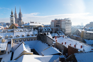 View over Zagreb during winter with snow with view to towers of church and cathedral and snowy roofs, Zagreb, Croatia, Europe