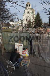 Artist painting religious image outside Alexander Nevsky Cathedral, Sofia. Bulgaria