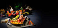 Shish kebab with various vegetables and spice country potatoes