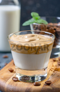 Cold milk with whipped coffee foam.