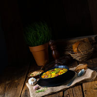 Rustic pea soup with bacon and sausages