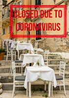 Empty tables and chairs of local restaurant in Corfu closed due to virus of Covid-19