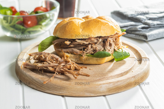 Sandwich with pulled meat.