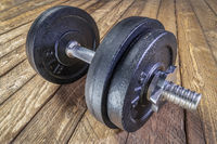 cast iron dumbbell on deck