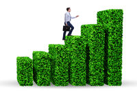Businessman in green ecology growth concept