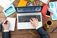 Close up businessman hands working at laptop