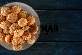 Amaretti, traditional Italian almond cookies, shot from above with a place for text